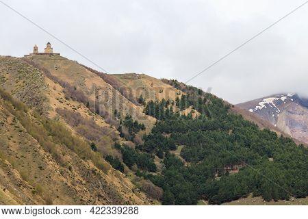 View On The Mount Kazbek And Gergeti Trinity Church (tsminda Sameba), Holy Trinity Church Near The V