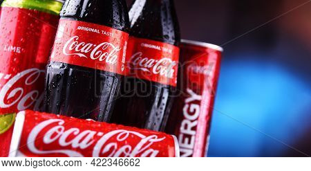Bottles And Cans Of Coca-cola
