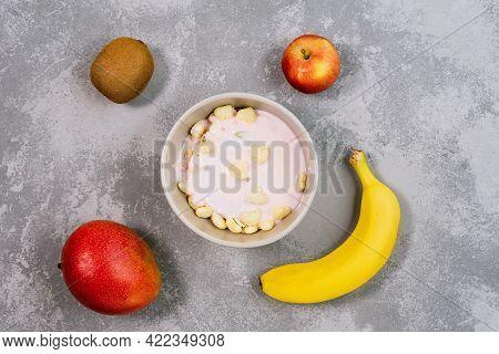 Healthy Food Granola In Bowl. Fresh Granola, Muesli With Kiwi, Banana And Nuts In Grey Bowl On Backg