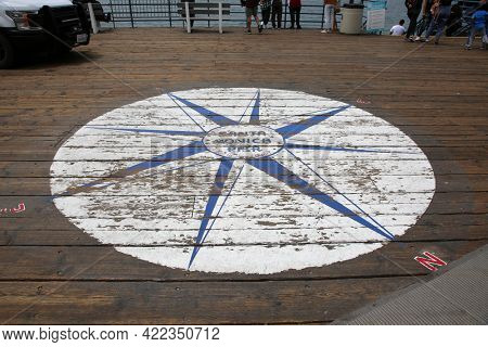 May 14, 2021 Santa Monica California, USA:  Santa Monica Pier Symbol painted on the board walk of the Santa Monica Pier. Editorial Use Only.