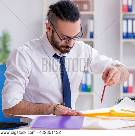 Architect working in his studio on new project