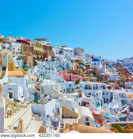 Oia town in Santorini Island in Greece. Buildings on the slope