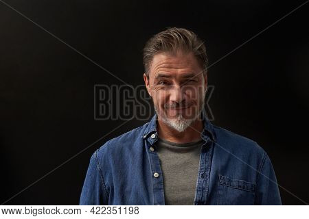 Portrait of mature age, middle age, mid adult man in 50s, happy confident smile. Copyspace.