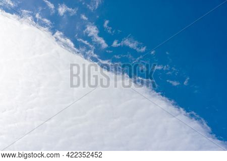 Border Of Dense Clouds And Blue Sky