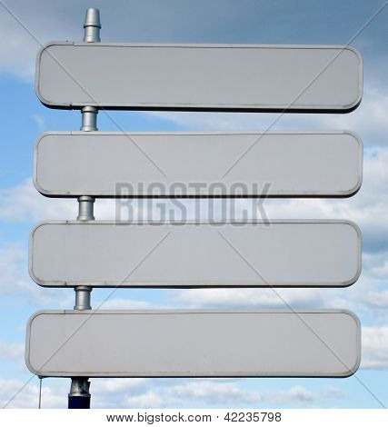 Signpost with 4 blank signs spaces