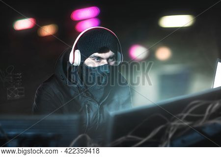 Hacker In The Office With Headphones With Microphone In Search Of Prey. Steals Data And Copy Of Bank