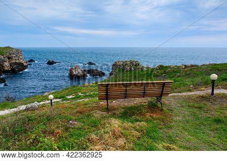 Black Sea View Near The Village Of Tyulenovo, Bulgaria. Bench By The Sea.