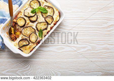 Greek Mediterranean Dish Moussaka With Baked Eggplants, Ground Beef In White Ceramic Casserole With
