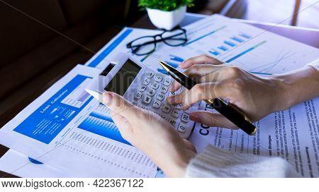 Bookkeeper Or Accountant Press Calculator To Calculate Loan, Finance, Tax, Income Company.