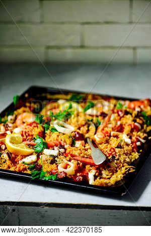 Spanish  Seafood Paella In A Oven. Top  View..selective Focus