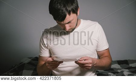 Caucasian Man Reading Instructions How To Use Medication By Nose Or Ear Drop Before Applying While S