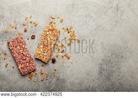 Assorted Healthy Cereal Granola Bars With Nuts, Seeds, Fruit And Berries On Grey Stone Background, Q