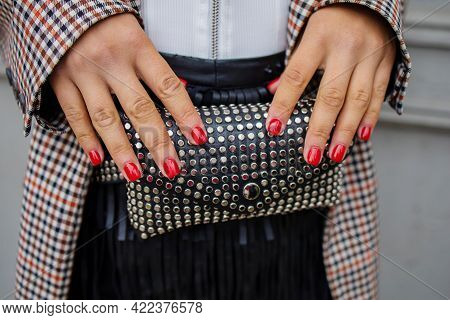 Woman With Black Leather Handbag With Silver Metal Studs
