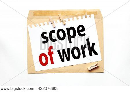 Scope Of Work. Text On White Paper On Craft Notebook