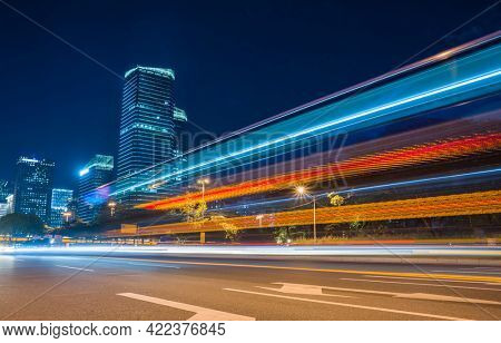 modern buildings in modern city from elevated road at night