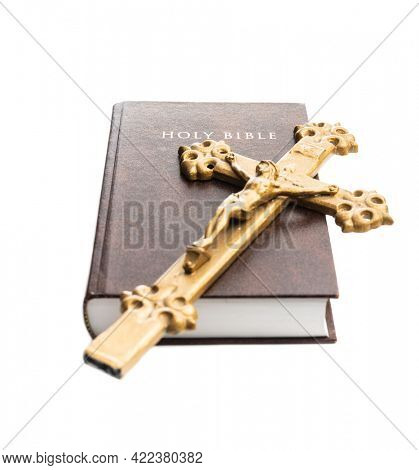 The holy bible and crucifix isolated on a white  background.