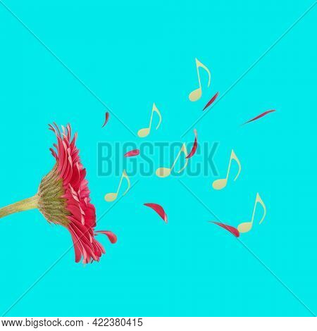 Trendy pink flower is playing music with petals and music notes. Abstract spring blue backdrop photo. Festive natural concept