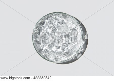 Transparent Cosmetic Gel In Glass Petri Dish On White Background. Concept Laboratory Tests And Resea