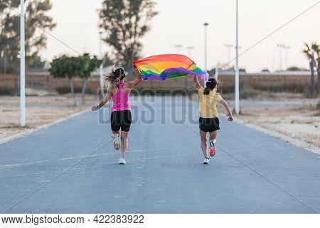 Lgbt And Lesbian Couple Concept. Sport. Rainbow Flag