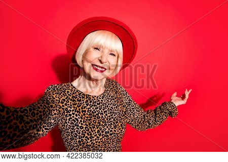 Photo Of Happy Nice Pretty Old Woman Show Hand Welcome Invite You Smile Make Selfie Isolated On Red
