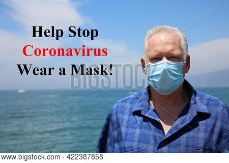 Man wearing a paper mask on his face. A man wears a Medical Face Mask to help avoid contracting Coronavirus aka Covid-19. Covid-19 is an Airborne Illness which has spread world wide. Wear A Mask.
