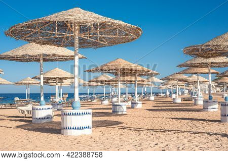 Background Of A Beautiful Equipped Sand Beach, Summer Vacation Concept. Summer Sandy Beach With Ocea