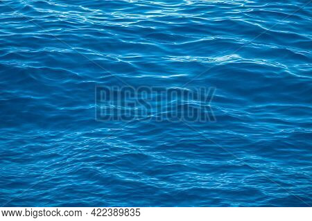 Blue Sea Water Background Texture. Abstract Background. Waves Of Water Of The River And The Sea Meet