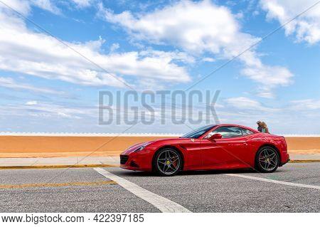 Palm Beach, Florida Usa - March 21, 2021: Red Ferrari California Luxury Car On Road