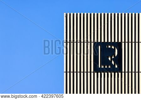 Southampton, UK - 31 May 2021: The top of the Lloyds Register Building against clear blue sky. The Lloyds register has been in existance since 1760 and classifies ships and shipping around the world.