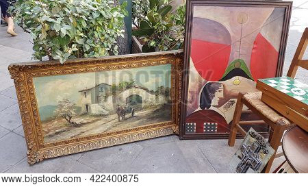 Old Oil Paintings In Ornate Picture Frames And Antique Stuff At Flea Market On Street In Athens, Gre
