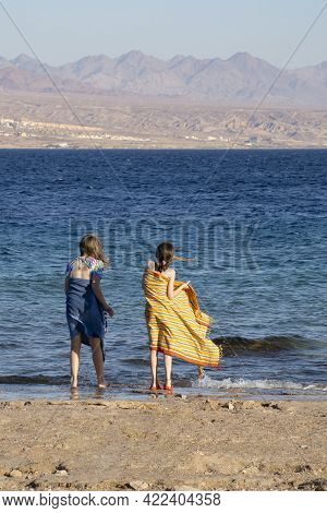 Eilat, Israel - May 24th, 2021: Two Girls In Bathing Suits And Towels, Standing On An Eilat, Israel,