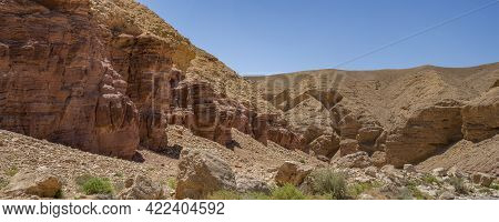 Red Sedimentary Rocks Next To Limestone Formations In The Red Canyon, Near Eilat, Israel, On A Clear