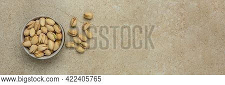 Pistachio Top View. Pistachios In A Saucer On A Marble Stone Table Top. Banner For Website Header, D