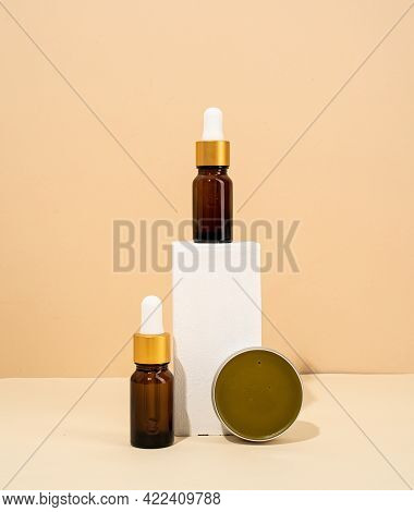 Brown Bottles Mockup For Natural Skincare Cosmetics, Spa Accessories On White Podiums, Cream Backgro