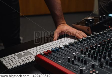 Producers Hands At The Keyboard In A Studio. Musician Arranging And Mixing Music In Home Studio. Mus
