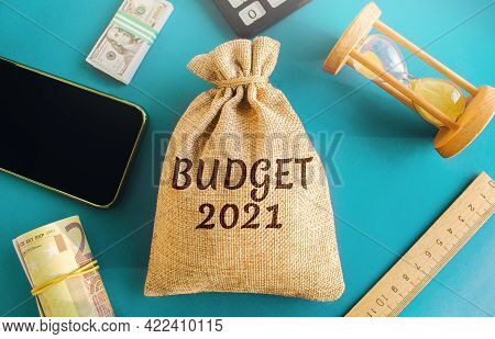Money Bag With The Word Budget 2021. Budgeting, Forecasting Income And Optimizing Expenses. Planning
