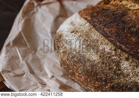 Texture Surface Of Baked Bread Crust On Craft Package. Beautiful Crispy Bread Close-up. Selective Fo