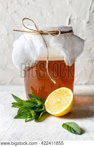Jar Of Raw Fermented Homemade Alcoholic Or Non Alcogolic Kombucha Superfood. Ice Tea With Healthy Na