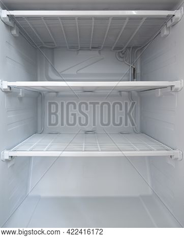 Empty Clean Freezer In The Fridge. Empty Shelves In The Fridge