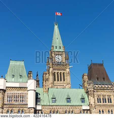 Ottawa, Canada - May 23, 2021: Parliament Building With Canadian Flag In The Capital Of Canada, Otta
