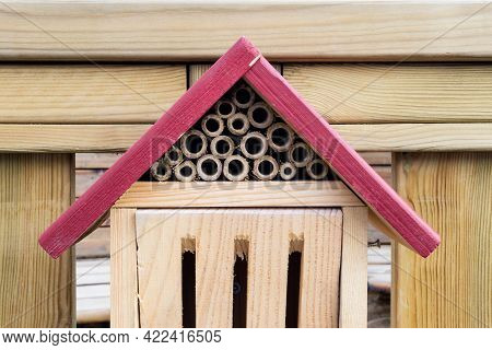 Stockholm, Sweden - March 29, 2021: Red Roof On The Top Insect Hotel Attached On Wooden Fence