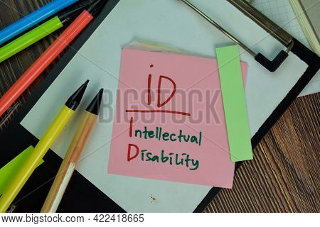 Id - Intellectual Disability Write On Sticky Notes Isolated On Wooden Table.