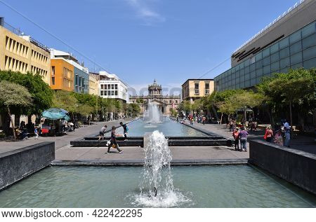 Guadalajara, Mexico - March 28 2021: A View Of A Fountain On Plaza Tapatia With The Cabanas Institut