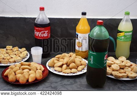 Minas Gerais, Brazil - May 30, 2021: Party Table With Savory Snacks And Soft Drinks