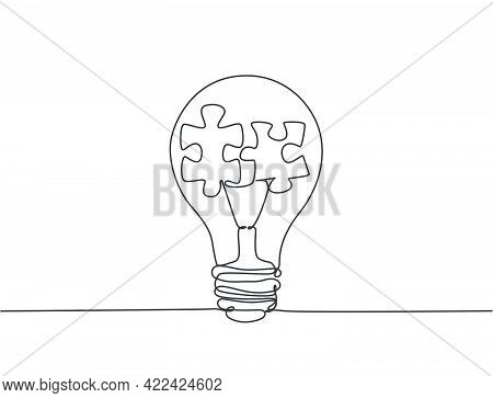One Single Line Drawing Of Lightbulb With Puzzle Pieces Inside For Creative Team Company Logo Identi