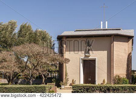 Santa Inez, Ca, Usa - April 3, 2009: San Lorenzo Seminary. The Beige Stone Church Under Blue Sky Wit