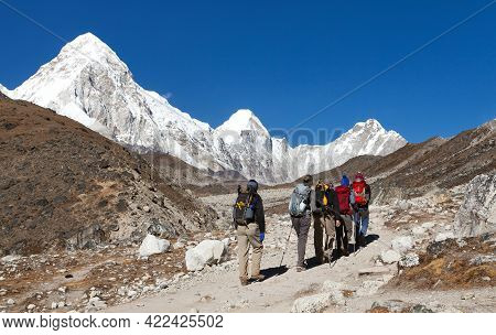 Group Of Tourists Going To Mount Everest Base Camp And Mount Pumori, Nepal Himalayas Mountains