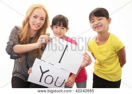 Girls studying in English with teacher