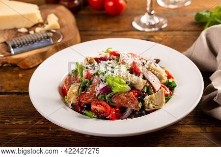 Italian Antipasto Salad With Salami, Artichoke Hearts And Olives