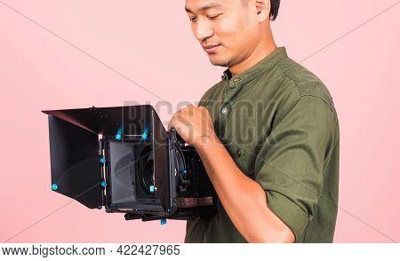 Portrait Of Asian Handsome Young Adult Man Confident Professional Videographer Handheld Holding Digi